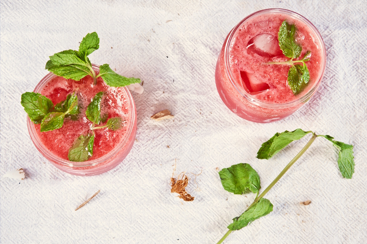 Bellinis garnished with mint make for an elegant cocktail perfect for the patio.