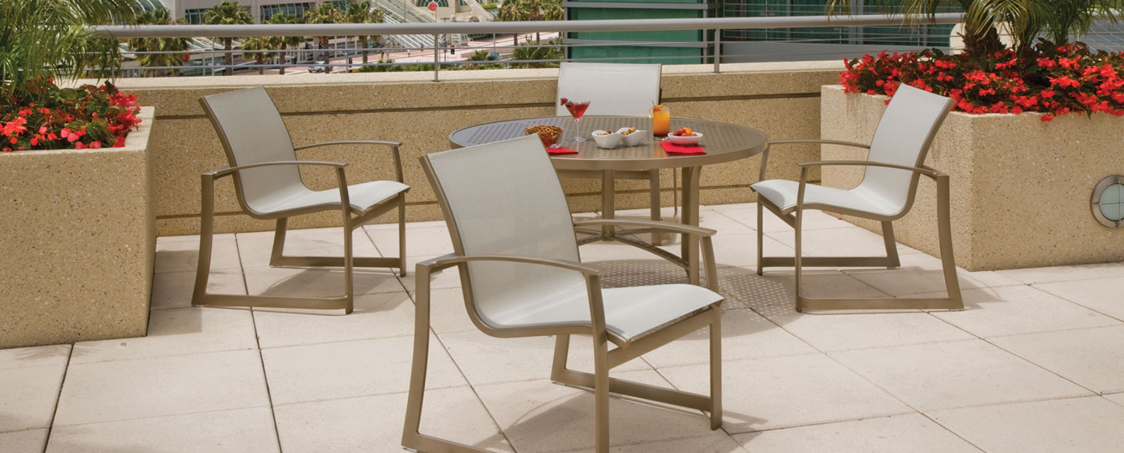 tropitones mainsail dining collection features a sled base and ergonomically curved back the sleek frames are made of sturdy weatherproof aluminum - Tropitone Patio Furniture